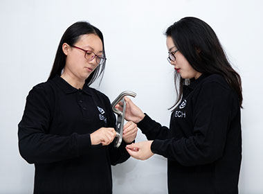 two employees checking products for sampling